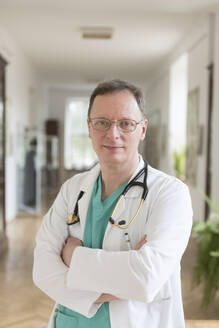 Lithuania, Vilnius, Portrait of doctor in a corridor of hospital - AHSF00639