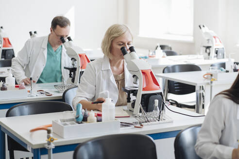 Lithuania, Vilnius, Senior researchers working in science class - AHSF00660