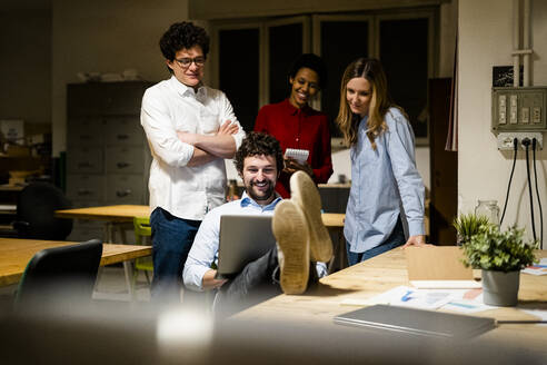 Coworkers having an informal meeting in office - GIOF06771