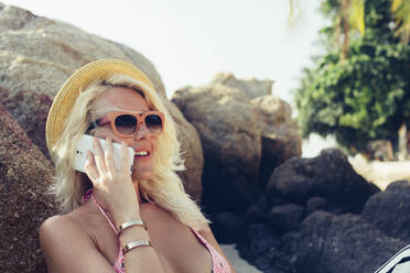 Caucasian woman talking on cell phone outdoors - BLEF10704