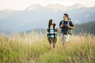 Caucasian couple hiking in remote landscape - BLEF10980