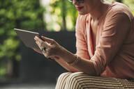 Caucasian woman using digital tablet outdoors - BLEF11265