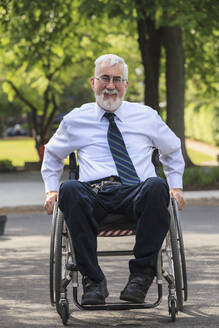 Caucasian businessman in wheelchair outdoors - BLEF11328