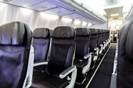 Empty chairs in airplane - BLEF11346