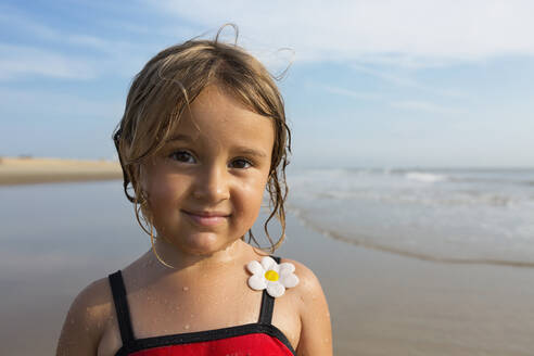 Mixed race girl smiling on beach - BLEF11520