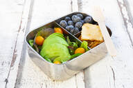 Lunchbox with salad, avocado and yellow tomatoes, crackers and blueberries - LVF08197