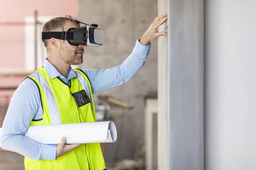 Architect with VR glasses at construction site - ZEF16139