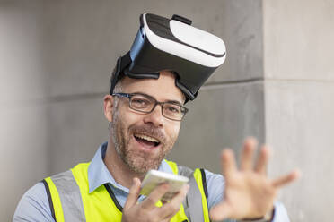 Architect with VR glasses at construction site - ZEF16142
