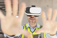 Architect with VR glasses at construction site - ZEF16145