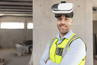 Architect with VR glasses at construction site - ZEF16151