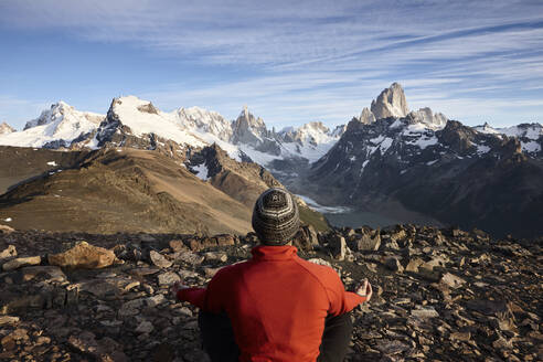 Man looking at Fitz Roy and Cerro Torre mountains, Los Glaciares National Park, Patagonia, Argentina - CVF01322