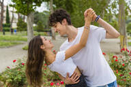 Young couple dancing in a park - MGIF00625