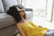 Young woman wearing virtual reality glasses - MRAF00416