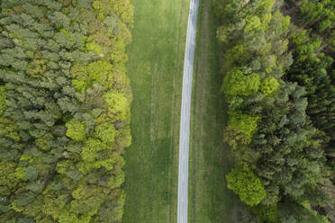 Aerial view of rural road with forest and meadows Franconia, Bavaria, Germany - RUEF02286