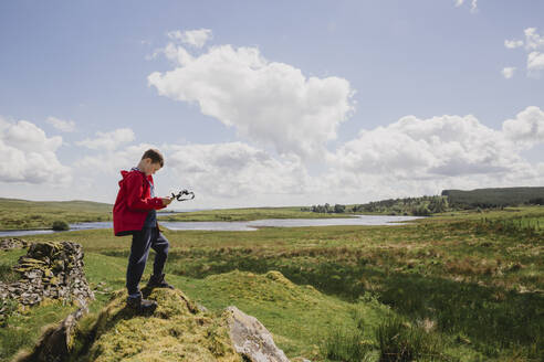 Boy looking at map, Cairngorms, Scotland, UK - NMS00335