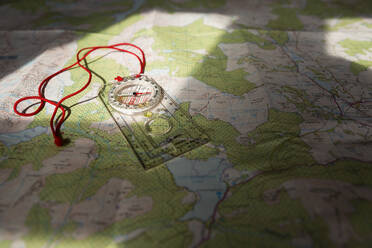 Compass on map, Scotland, UK - NMS00338