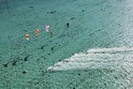 Aerial view of people kitesurfing on ocean - BLEF12084