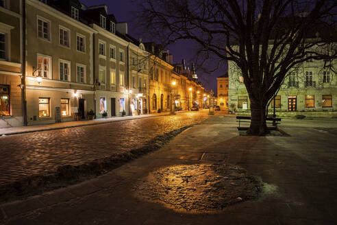 Houses along atmospheric Freta Street at New Town Square at night, Warsaw, Poland - ABOF00421