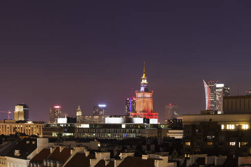 Poland, Warsaw, capital city skyline, downtown district cityscape at night - ABOF00430