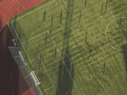 Aerial view of football player on soccer field, Tikhvin, Russia - KNTF02947