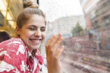 Happy young woman travelling by train - WPEF01640