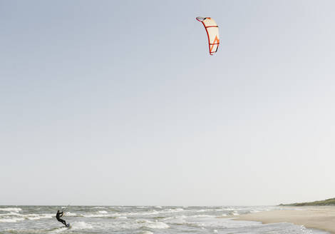 Kiteboarder riding the waves - AHSF00730