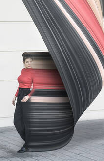 Digital composite of young woman moving in front of a wall - UUF18352