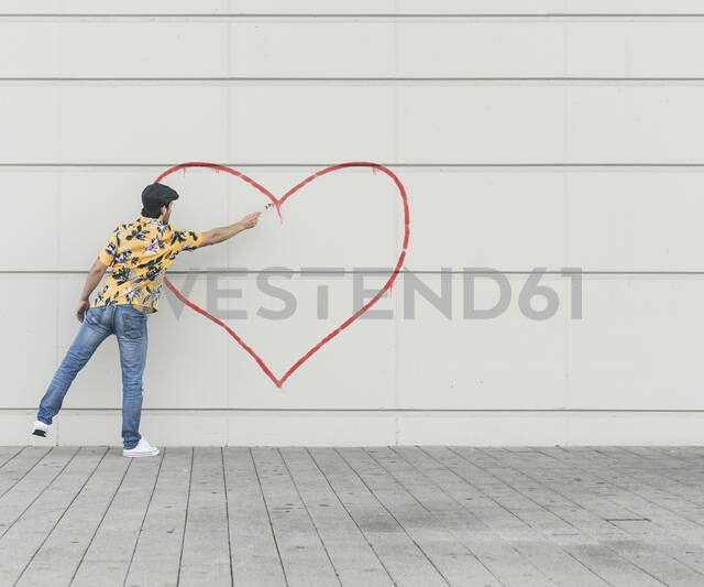 Digital composite of young man drawing aheart at a wall - UUF18358 - Uwe Umstätter/Westend61