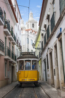 Tram moving in alley of Alfama at Lisbon - RUN02878