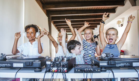 Young friends having a party at the turntable - LJF00549