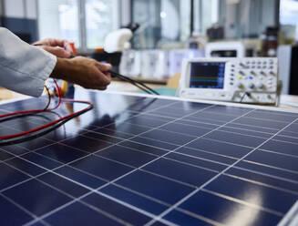 Technician controlling cables of solar panel - CVF01396