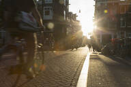 Blurred view of bicyclist on city street - BLEF12389