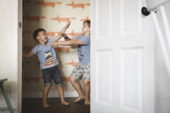 Two brothers play fighting at home - EYAF00325