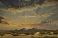 Dramatic sunrise over mountains in remote landscape - BLEF12705