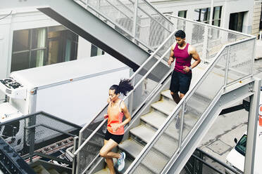 Couple jogging on city steps - BLEF12813