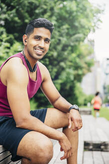 Indian athlete resting in city - BLEF12819