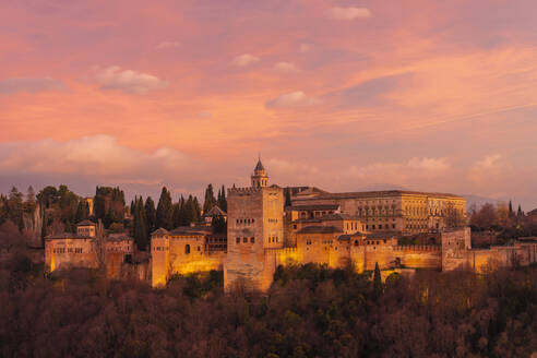 View of Alhambra with mountain Sierra Nevada in the background at sunset, Granada, Spain - TAMF01867