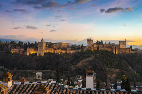 View of Alhambra with Sierra Nevada in the background at sunset, Granada, Spain - TAMF01870