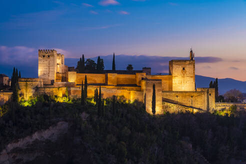 View of Alhambra with Sierra Nevada in the background at sunset, Granada, Spain - TAMF01873