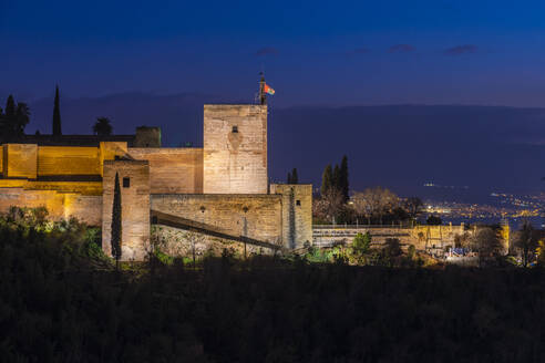 View of Alhambra with Sierra Nevada in the background at night, Granada, Spain - TAMF01909