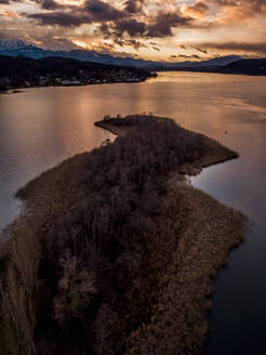 Aerial view of lake against sky at Pörtschach am Wörthersee during sunset, Carinthia, Austria - DAWF00888