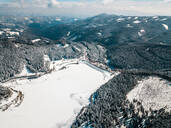 Aerial view of mountains against sky during winter at Styria, Austria - DAWF00894