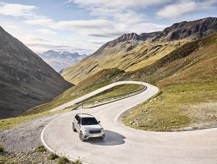 Sports Utility Vehicle on high alpine road, Timmelsjoch, Tyrol, Austria - CVF01421