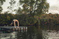 Young man diving into lake - GUSF02364