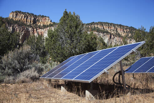 Solar panels in remote field near mountains, Zion National Park, Utah, United States - BLEF13095