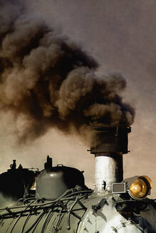 Close up of billowing smoke stack on train - BLEF13098