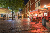 Illuminated cobblestone Street at the old town by night, Prague, Czech Republic - TAMF01951