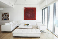 Sofas, coffee table and wall art in modern living room - BLEF13267