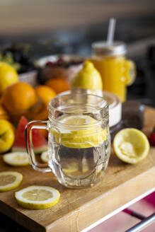 Lemon infusion on kitchen table with various fruit - AFVF03603