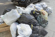 Trash bags in the streets of London, UK - TAM02023